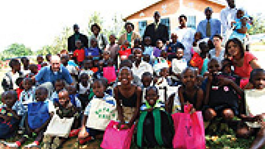 Compassion sponsored children in a group photo with some of their sponsors recently (photo. C.Kwizera)
