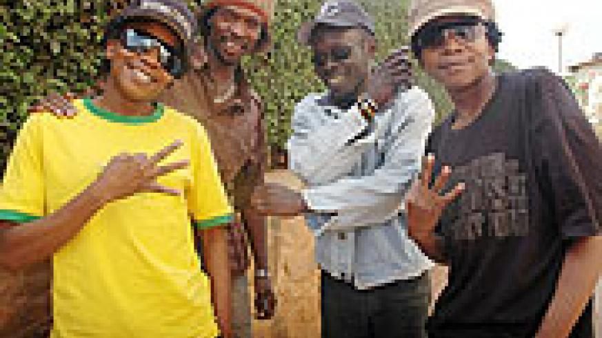 (L-R) Wasswa, VD Frank, Denis and Kato pose for a group photo at The New Times' Head offices in Kacyiru. (Photo by J. Mbanda).