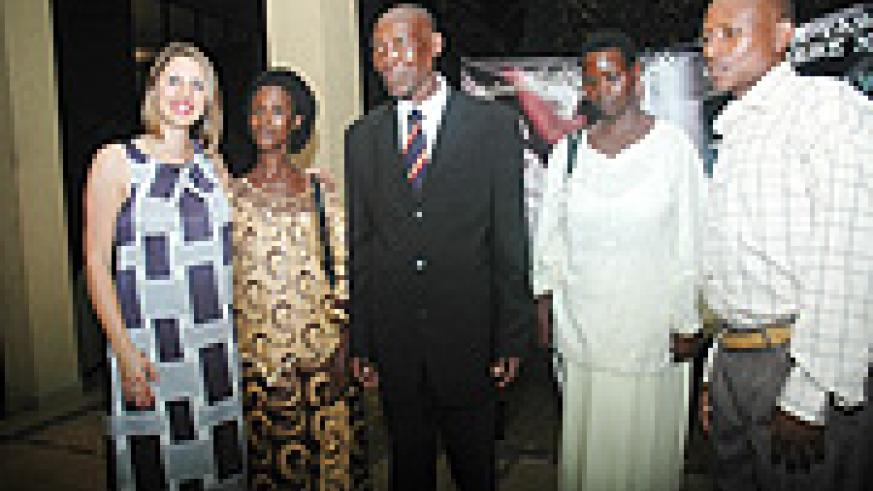 """The Director of the documentary """"As We Forgive"""", Laura Waters Hinson poses for a group photo with the actors; Chantal, John, Rosaria and Saveri. (Photo, by J. Mbanda)."""