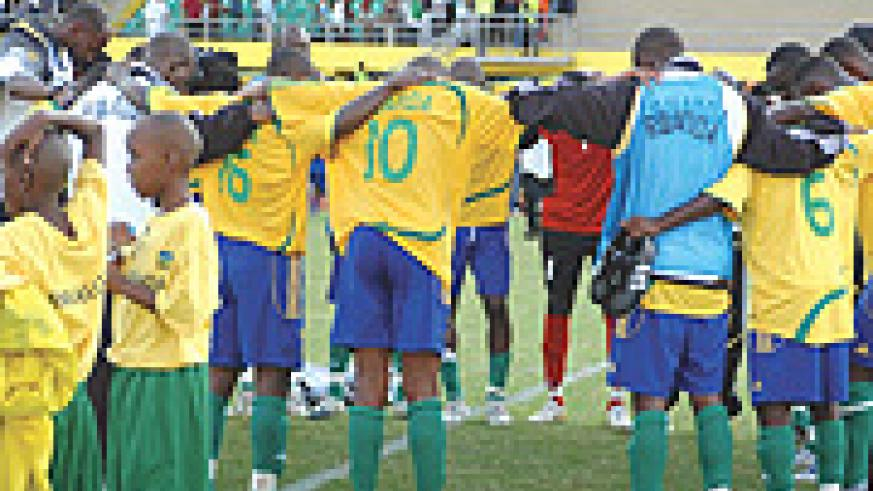 PRAYER TIME: Amavubi players having a prayer in the middle of the field after their goalless draw against Algeria back in March. The team needs all the prayers they can master if they' re to get anything from today's game against reigning African champion