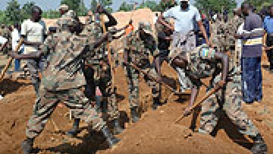 RDF soldiers working on a site in Kicukiro District during the Army Week.