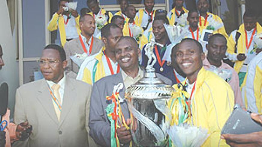 YES WE CAN: Victorious Atraco received a heros' welcome on their arrival at Kigali International Airport yesterday. Atraco vice president Issa Ngezi (C), Sports minister Joseph Habineza and Ferwafa vice president Vedaste Kayiranga, team captain Jean Shyak