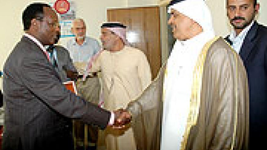 (4-WELCOME; State Minister for Energy Albert Butare (L) greets Essa Abdulla Al Noaimi the head of the delegation at the latter's office on Wednesday. (Photo J. Mbanda)
