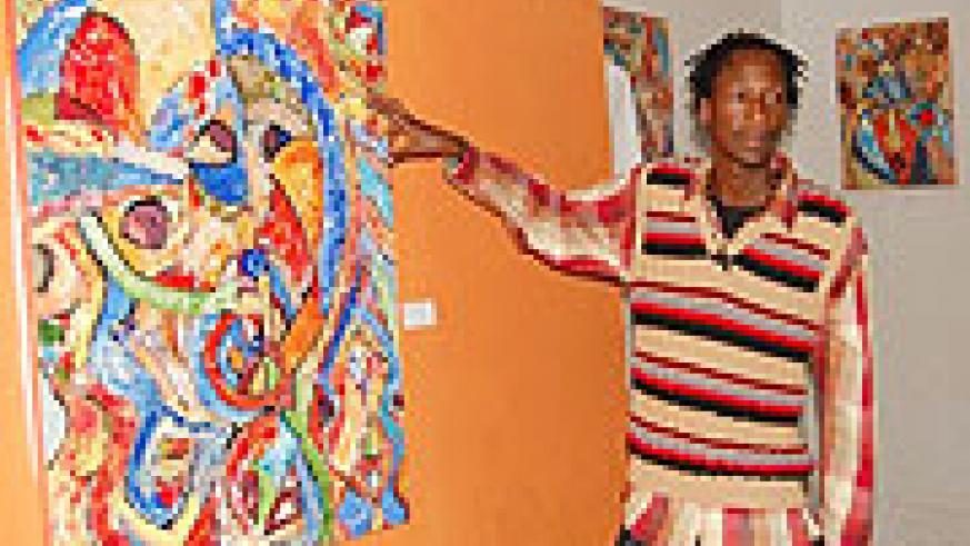 Nkurunziza shows off one of his finished work at Torero Cafe