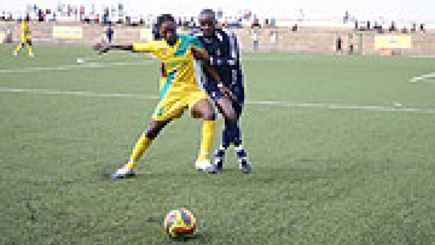 Atraco's Andre Lomami tries to hold off Police's Tambwe Ngoyi in yesterday's MTN Peace Cup quarter-final second leg. Atraco won the contest 1-0. (Photo: F. Goodman)