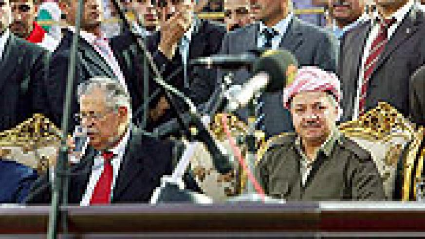 Iraqi President Jalal Talabani, left, and Massoud Barzani, president of the Kurdish regional government in Iraq, attend a launch rally for the region's parliamentary campaign season on June 25, 2009