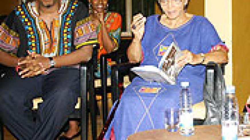 """Ambassador Cynthia Shepard (right) shows her book """"All things Being Equal"""" to Amin Gafaranga, the founder of Shokola during the launch of the African Literature Library. (Photo, by H. Goodman)"""