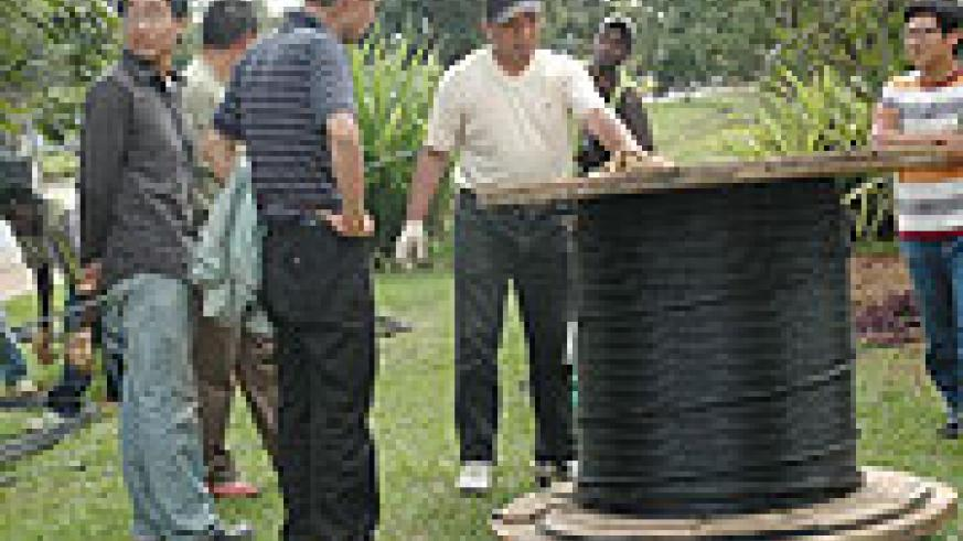 Chinese technicians lay fibre optic cables in Kigali(File photo).