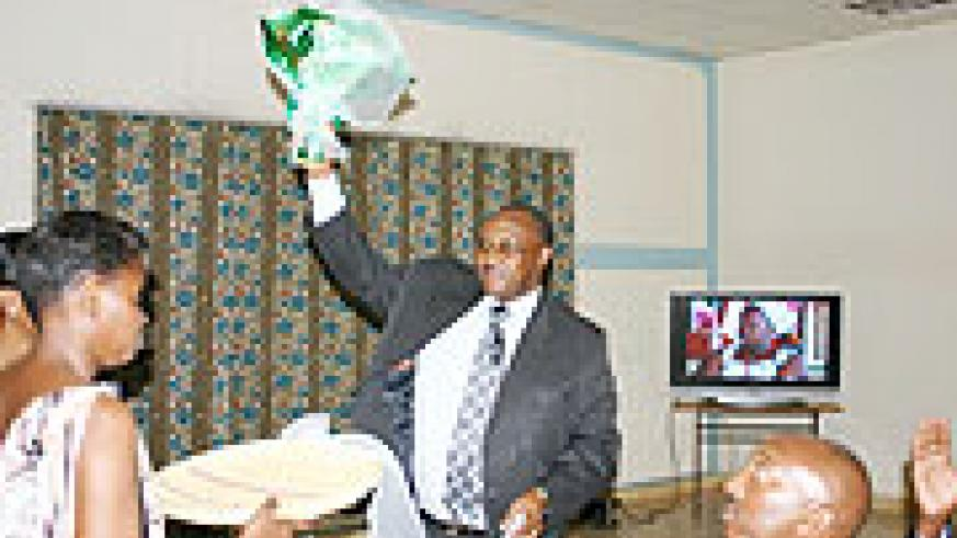 I'M OFF; Former Minister of Local Government Protais Musoni after receiving a gift from the ministry staff during his farewell (Photo; F. Goodman)