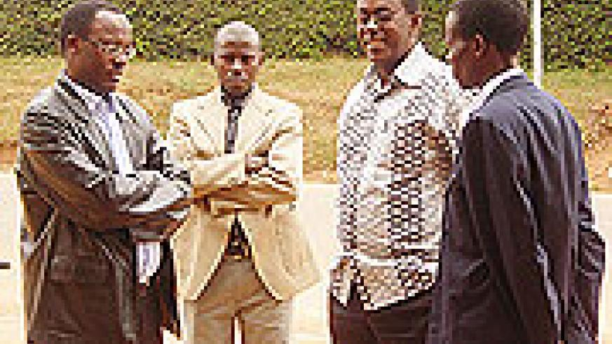 L-R Governor Fidele Ndayisaba, Huye district Exec Secretary Vedaste Nshimyimana, PM Bernard Makuza and a National University of Rwanda lecturer after touring different areas of Butare town (Photo P Ntambara