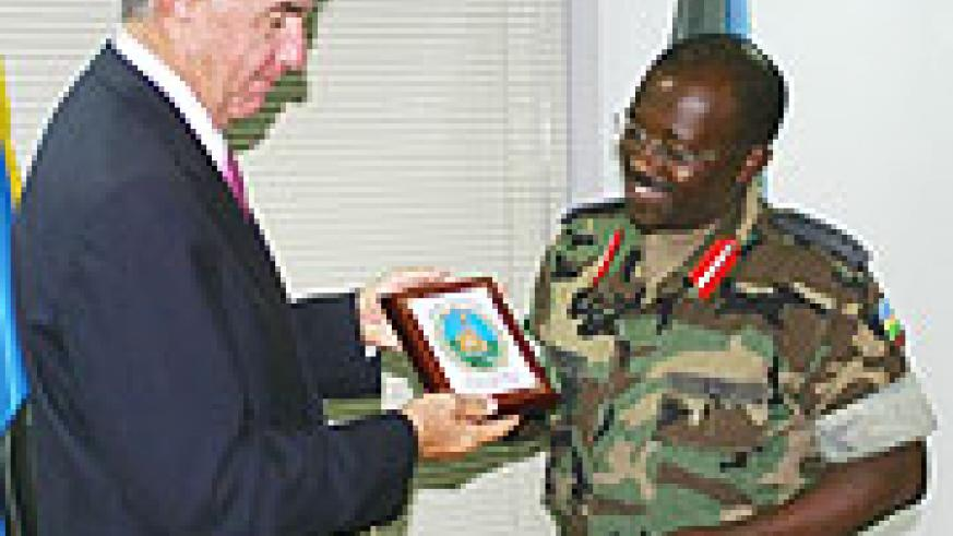 Lt. Gen. Charles Muhire presents a gift  to General Joe Ashy (Photo F Goodman).