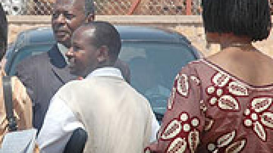 Munyanganizi Bikoro  (in suit) with family members and friends outside court. (Photo J Mbanda).