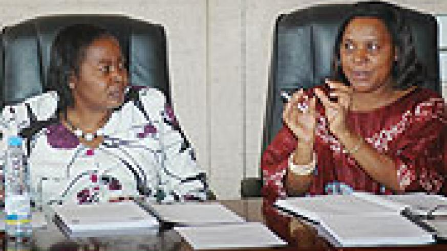 Out going FFRP chairperson Hon. SpecioseMukandutiye (R) addresses the media as her successor Sen.Maria Mukantabana looks on yesterday. (Photo; J Mbanda)