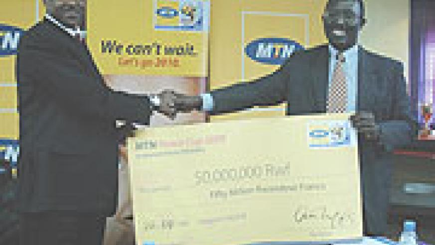 Ferwafa boss Jean Bosco (L) and MTN Chief Operating Officer Andrew Rugege after signing a Rwf50M sponsorship deal for Peace Cup back in April. The two partners are in talks to have MTN sponsor the league.