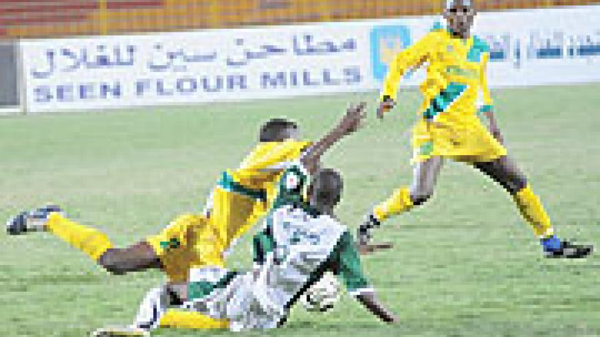 Jean Shyaka  closes in on Mathare United's Ken Opiyo battling against Peter Kagabo (2) during the Cecafa club chammpionship in Sudan. Shyaka and Kagabo have agreed to sign new contracts with Atraco.
