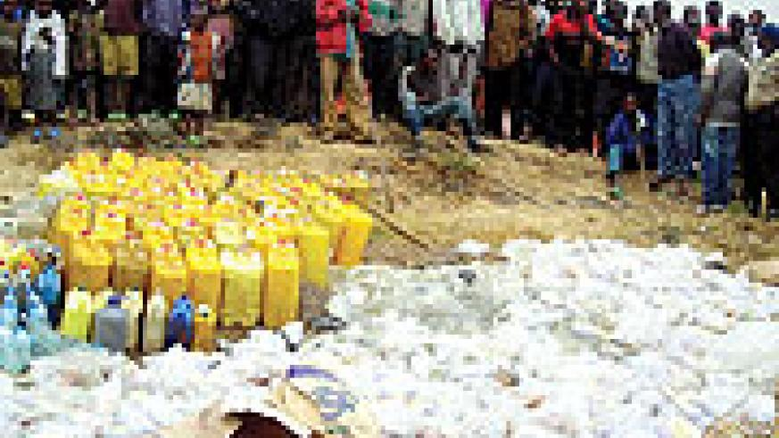 Residents in Cyanika gather to witness the destruction of illicit drugs on Sunday.