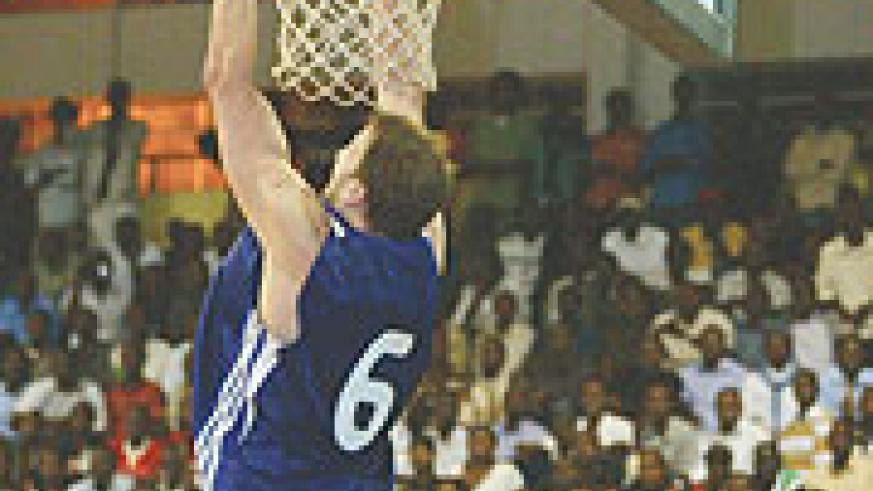 TOP REBOUNDER: Rwanda's Robert Thompson takes a dunk during the Zone 5 Championship in staged in Kigali eraly this year. Thompson won the Best Rebounder award at the Fiba Afrobasket Championships in Libya.
