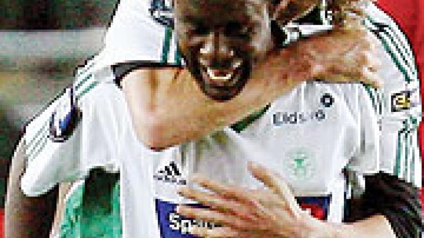 Olivier Karekezi  celebrates with a teammate after scoring for Ham Kam last season.
