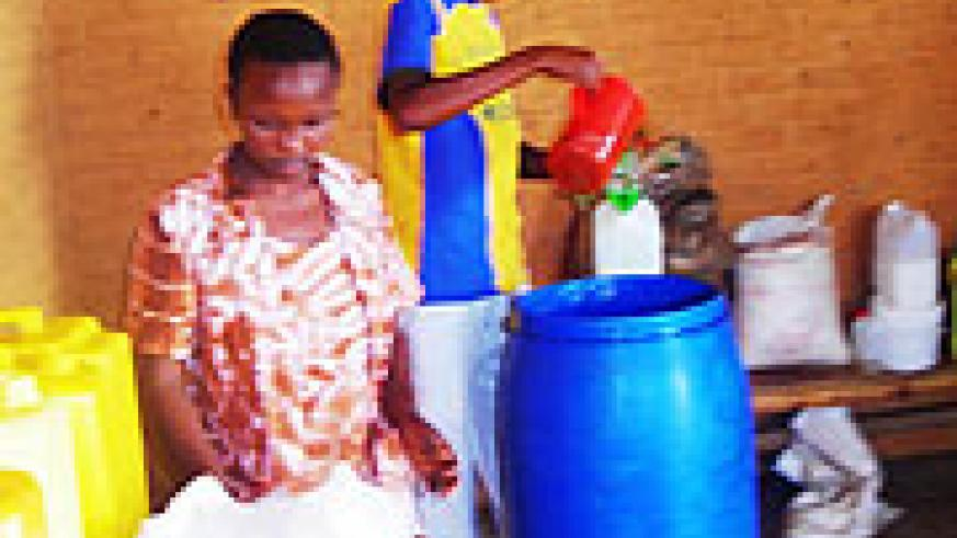 Juvenile  at work in a liquid soap industry in Gishari. (Photo S Rwembeho).