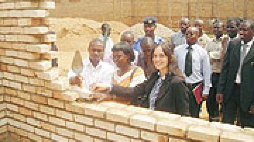 L-R Huye Mayor Francois Uhagaze, the Headmistress of Karama Primary School and Esther Kronsbein the Cordinator of Human Help Network during the launch of construction works of a 6 classroom block (Photo: P. Ntambara)