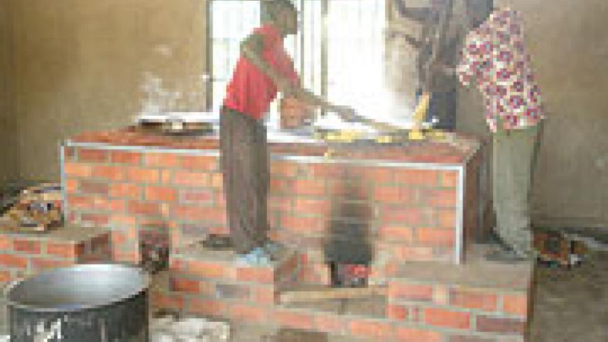 Cooks at Mayange Primary school use the stove for the first time. (Photo Irene V. Nambi).