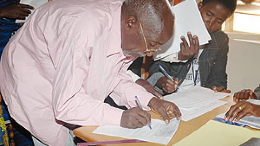 One of the former evictees signing for his cheque (Photo F. Goodman ).