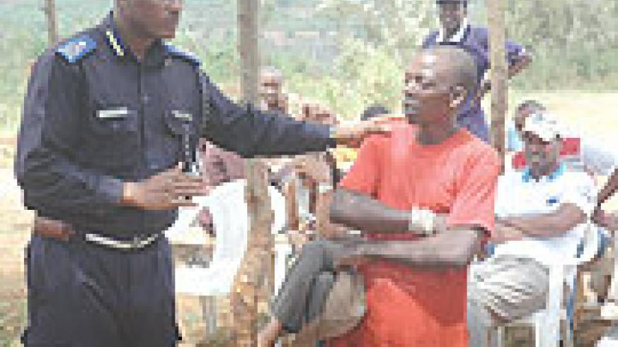 Supt. Emmanuel Butera in charge of Community Policing explains to the locals of Mbandazi cell, Rusororo Sector on the dangers of drug abuse, yesterday. (Photo/ F.Goodman)
