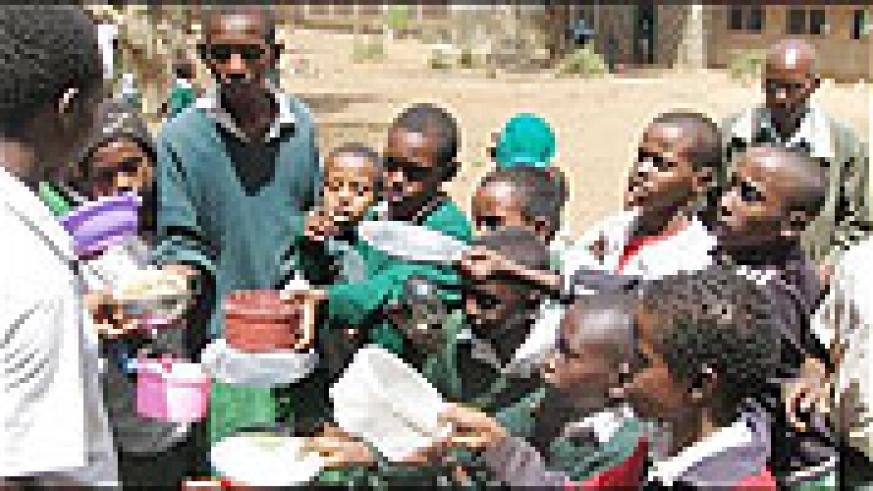 St Kizito Primary School pupils asking for second helpings of food