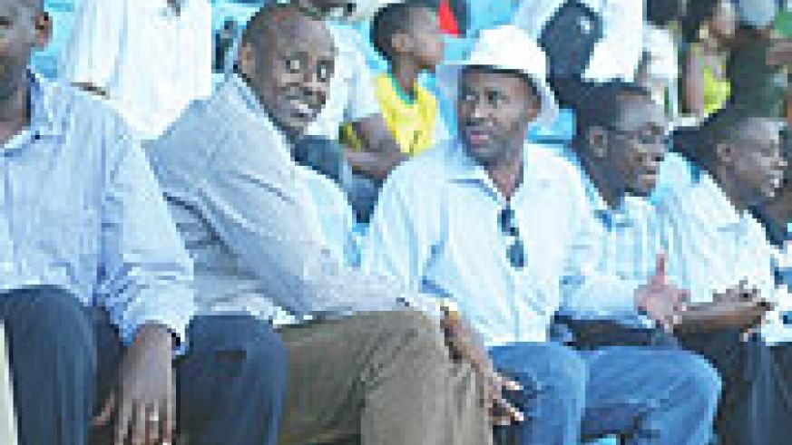 RETAINED: Senator Valens Munyabagisha (in hat) enjoys a local league match besides Ferwafa boss Jean Bosco Kazura (L) and Prime Minister Bernard Makuza last season. The senator was retained as Rayon Sport president despite earlier reports that he was plan