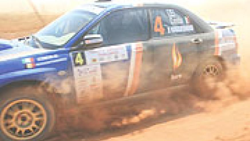 Costa Olivier rises dust in his Subaru Imprezza on day two of Zimbabwe challenge rally.