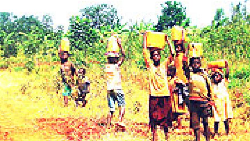 Rural children involved in domestic work during class hours.(Photo S/Rwembeho)