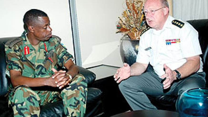 Gen. James Kabarebe (L) with his Belgian counterpart Gen. Charles Henri Delcour at Kigali international Airport on the latter's arrival yesterday. (Photo/ J. Mbanda)