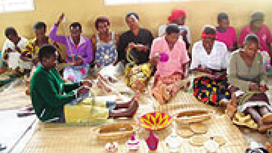 Women weaving the precious AGASEKE. (Photo S Rwembeho)