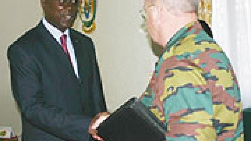 Prime Minster Bernard Makuza bidding farewell to Belgian Chief of Defence Gen Charles-Henri Delcour after their meeting. (Photo; F. Goodman)