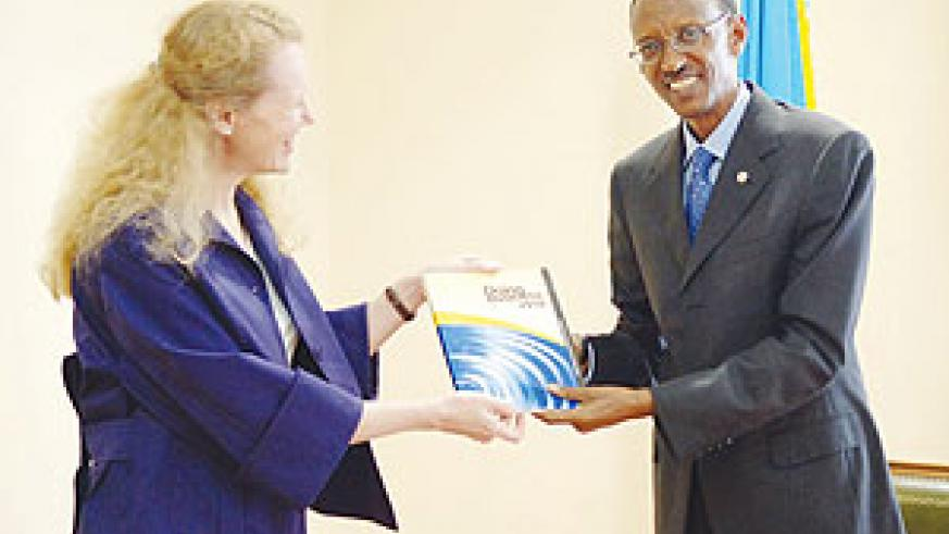 President Kagame receives a copy of the 2010 Doing Business Report from Penelope Brooks of the World Bank (Urugwiro photo)