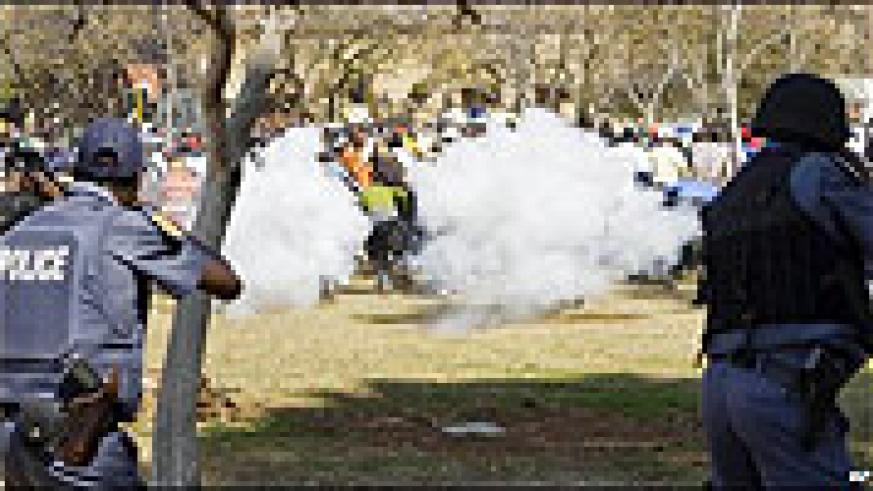 South African Riot Police quelling soldiers protests with tear gas