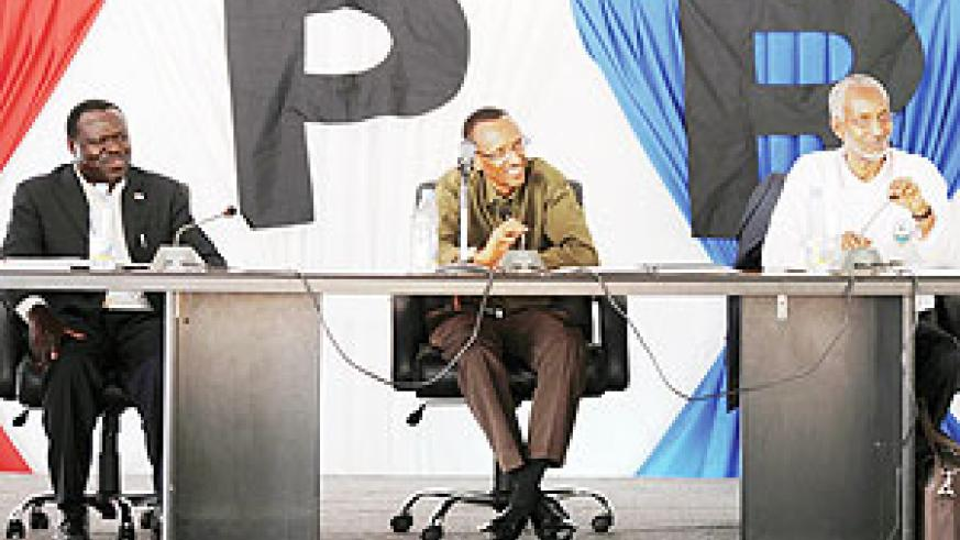 President Paul Kagame at the RPF Political Bureau meeting yesterday. Left is the party's vice chairman Christophe Bazivamo while on the right is the Secretary General, François Ngarambe.