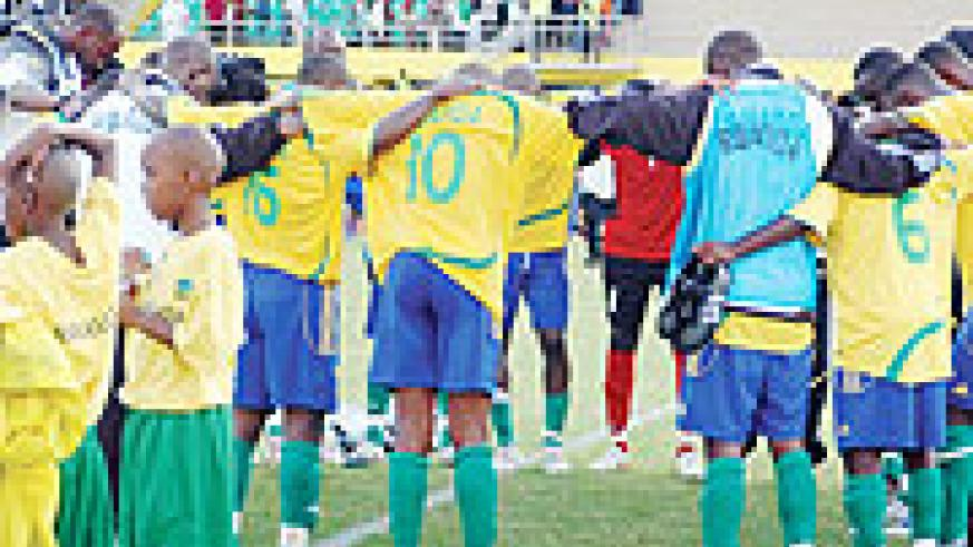 Amavubi players gather for a word of prayer before their goalless draw in the first leg against Algeria. The team enters camp next Tuesday ahead the return leg on October 10.