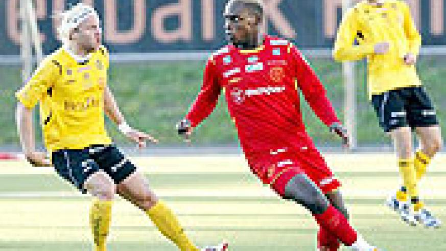 Bobo Bola tries to get past a BK player in the Superettan league.