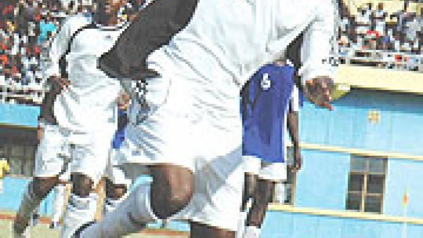 BACK WITH A BANG: Abbas Rassou protects the ball during a past encounter with Rayon Sport. Yesterday, the striker scored APR's lone goal against Police to guide the club into the semi-final of the Pre-season tournament. (File Photo)