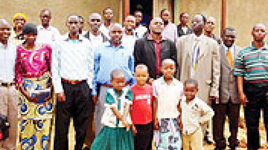 Pastor Emmanuel Rugazura and christians pose for a photo in Kayumbu, Kamonyi District. (Photo / D. Sabiiti)