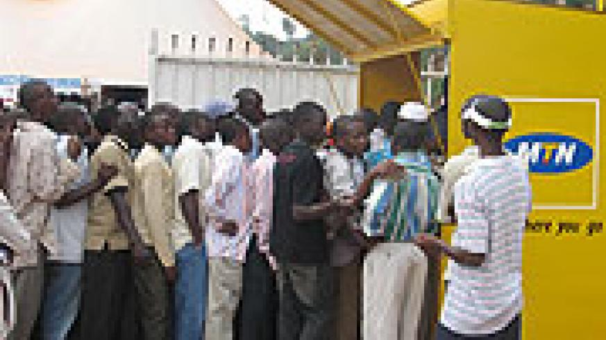 Revellers scramble for MTN products. (File Photo)