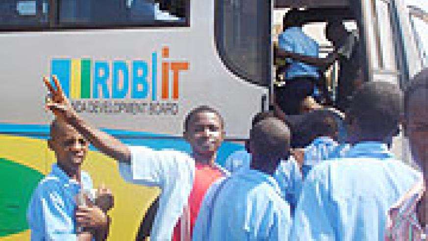 Ecstatic students board one of the ICT buses (Photo D.Sabiiti)