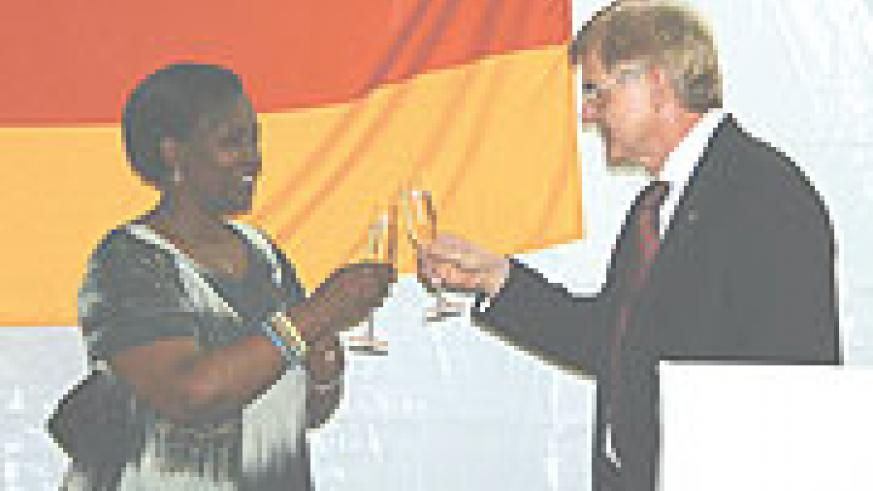 Foreign Affairs Minister, Rosemary Museminali and German Ambassador to Rwanda, Elmar Timpe, toast during the celebrations on Friday.