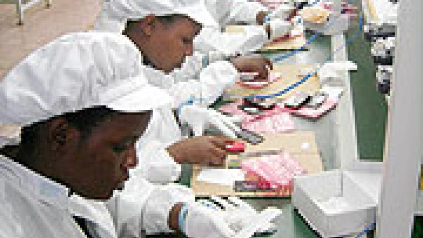 Workers at the A-Link mobile phone assembly plant in Kigali Rwanda(File photo)