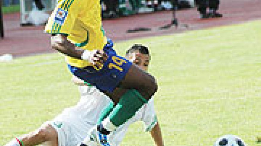 Abedi Makasi goes to the ground after being tripped by an Algerian player in the first leg which ended in a goalless draw. The striker has been ruled out of Sunday's game after suffering a knee injury. (File Photo