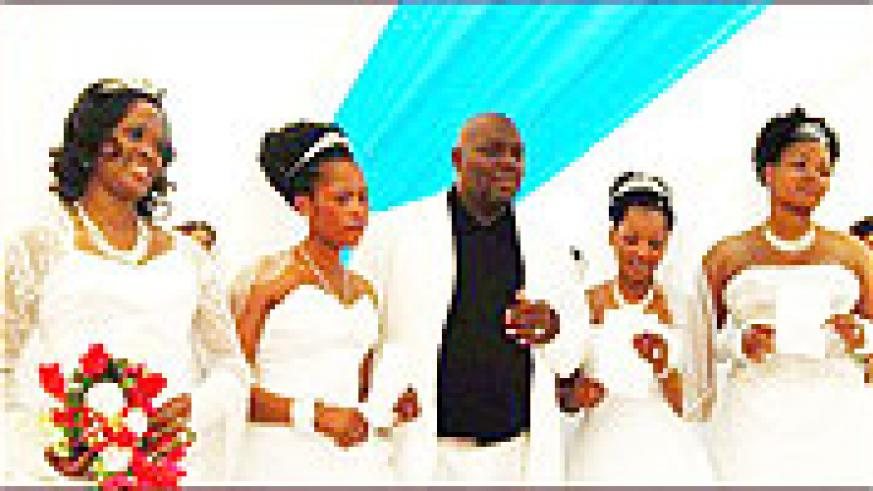 Milton Mbele and his four brides that he married on the same day.