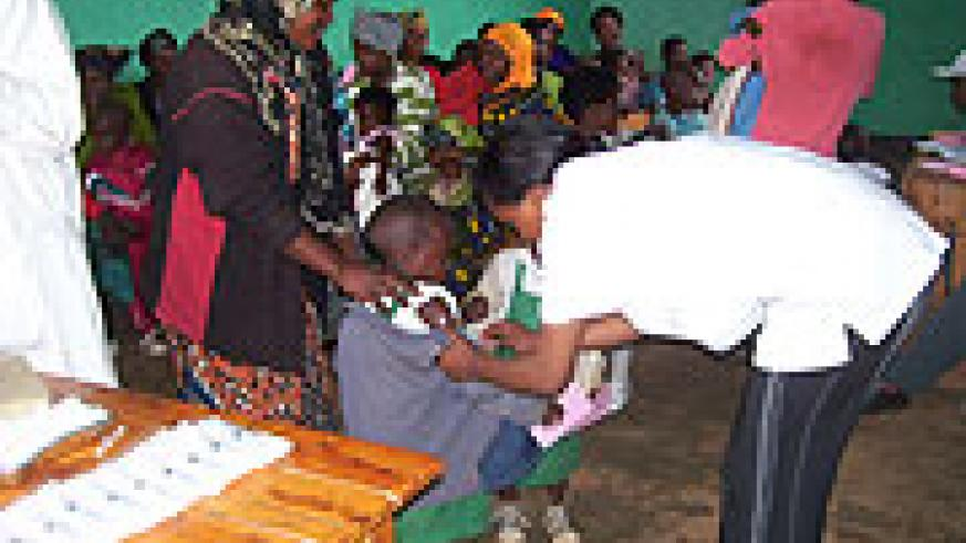 A nurse vaccinates a child at Gacurabwenge Cell during the ongoing immunisation programme. (photo/ A.Gahene)