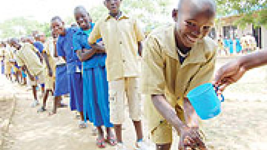 Pupils of Rwesero Primary School washing hands before being dewormed yesterday (Courtesy Photo)