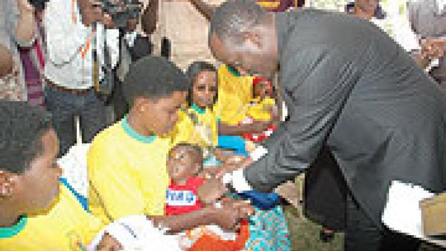Health Minister Dr. Richard Sezibera taking part in the Immunisation exercise in Gashora early last week.